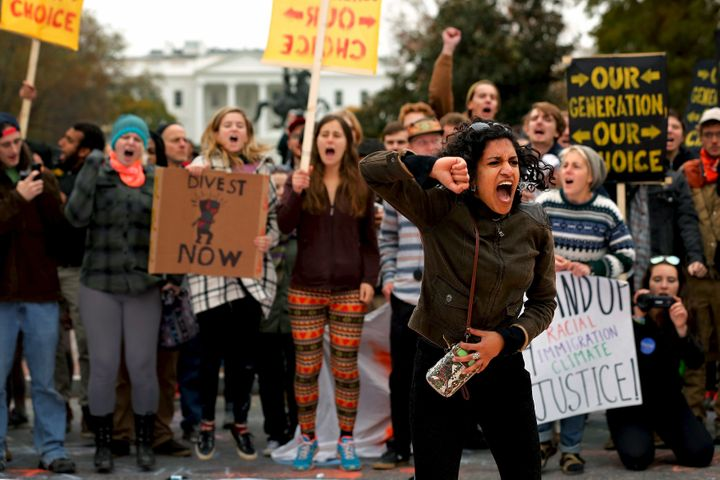 "In a photo from three years ago, Varshini Prakash, then with the Divestment Student Network leads chants of ""I believe that w"