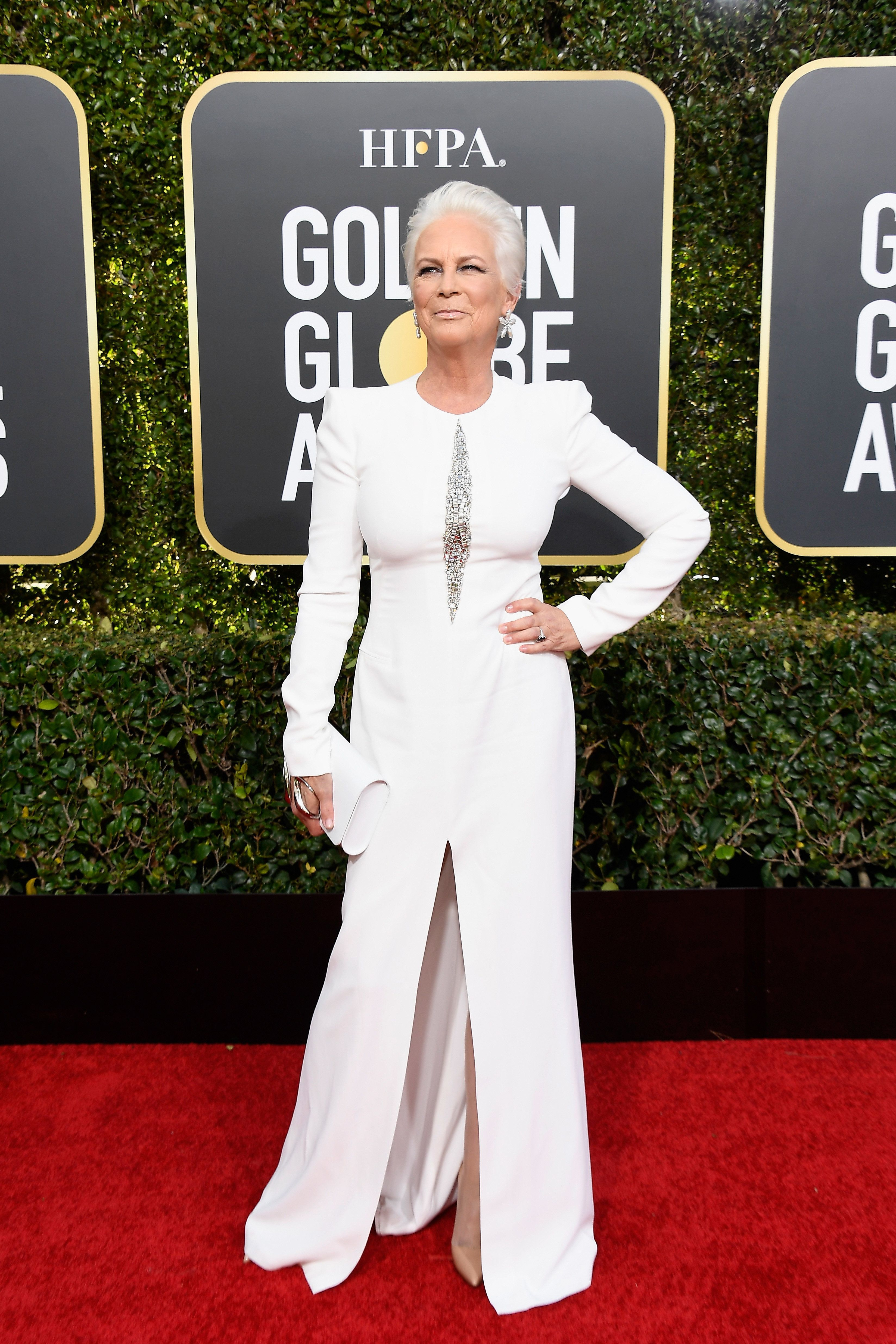 <p><span>Jamie Lee Curtis went for an all-white ensemble, looking fierce in a long-sleeved dress with a thigh-high split. Photo:Getty Images</span> </p>