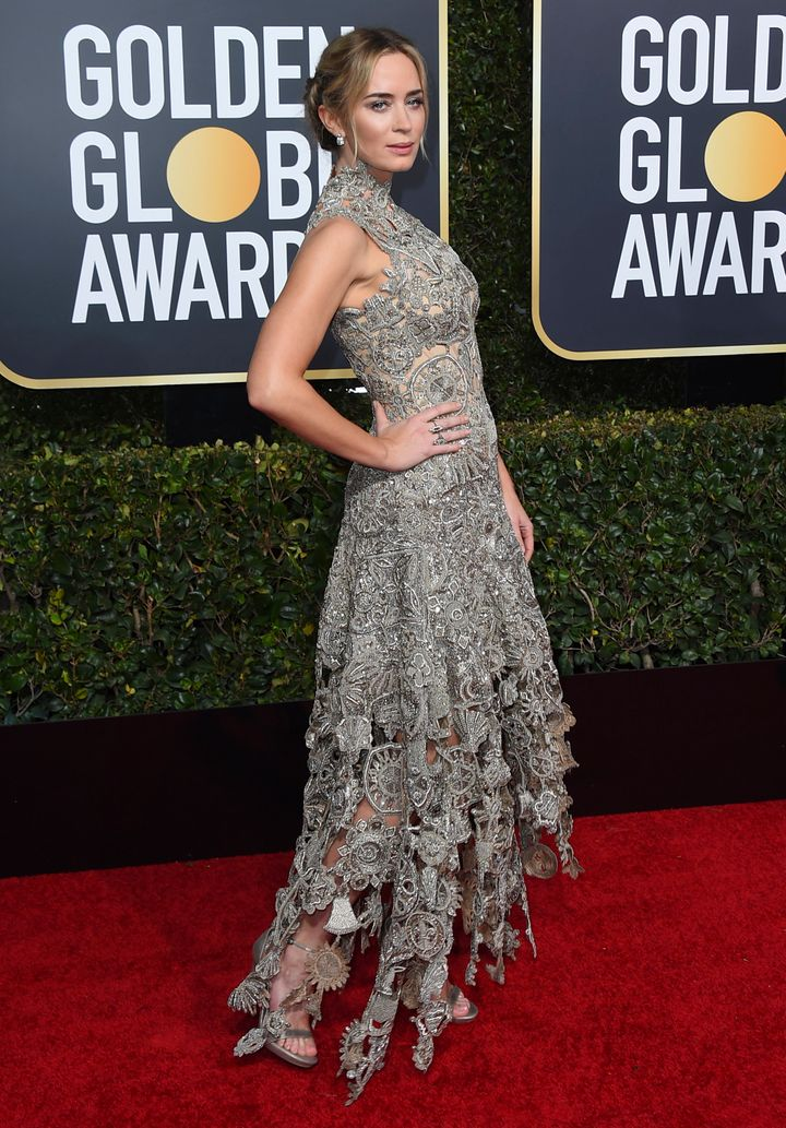 Blunt's silver dress is by Alexander McQueen.