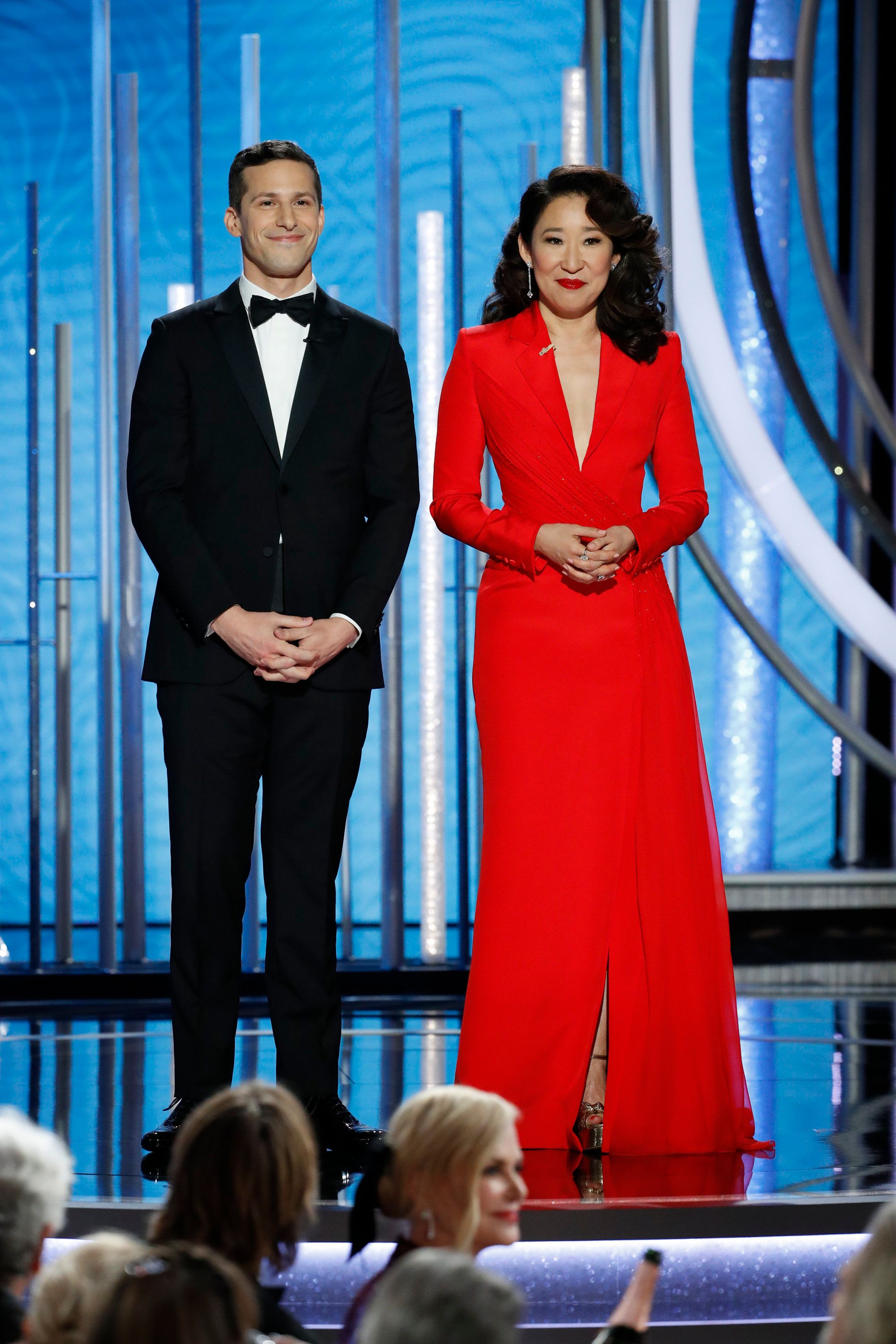 BEVERLY HILLS, CALIFORNIA - JANUARY 06: In this handout photo provided by NBCUniversal, Hosts Andy Samberg and Sandra Oh  speak onstage during the 76th Annual Golden Globe Awards at The Beverly Hilton Hotel on January 06, 2019 in Beverly Hills, California.  (Photo by Paul Drinkwater/NBCUniversal via Getty Images)