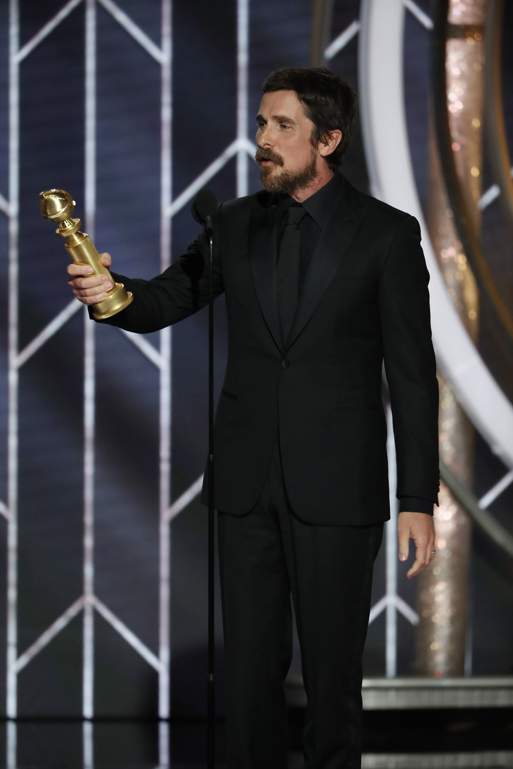 "BEVERLY HILLS, CALIFORNIA - JANUARY 06: In this handout photo provided by NBCUniversal, Christian Bale from ""Vice"" accepts the Best Actor in a Motion Picture – Musical or Comedy award  onstage during the 76th Annual Golden Globe Awards at The Beverly Hilton Hotel on January 06, 2019 in Beverly Hills, California.  (Photo by Paul Drinkwater/NBCUniversal via Getty Images)"