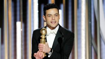 "This image released by NBC shows Rami Malek accepting the award for best actor in a motion picture drama for his role as Freddie Mercury in a scene from ""Bohemian Rhapsody"" during the 76th Annual Golden Globe Awards at the Beverly Hilton Hotel on Sunday, Jan. 6, 2019, in Beverly Hills, Calif. (Paul Drinkwater/NBC via AP)"