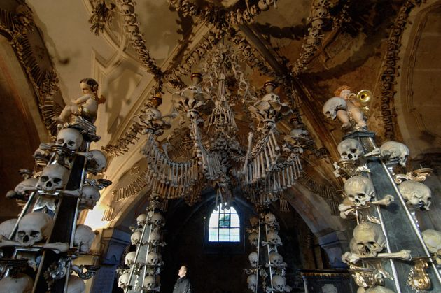 A bone-chandelier hanging over 4 Gothic pinnacles in the Sedlec Ossuary, beneath the Cemetery Church...
