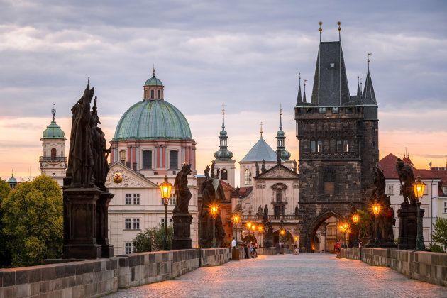 Photograph taken at sunrise Photograph taken on Charles Bridge, Prague Old Town Bridge Tower (right) St. Francis Of Assissi Church - Kostel svat�o Franti?ka z Assisi (left)