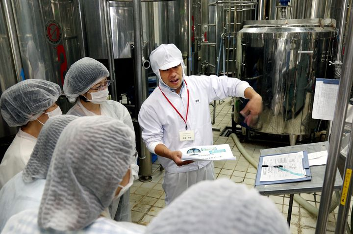Seikatsu Club members visit the factory where the cooperative is developing its own yogurt.