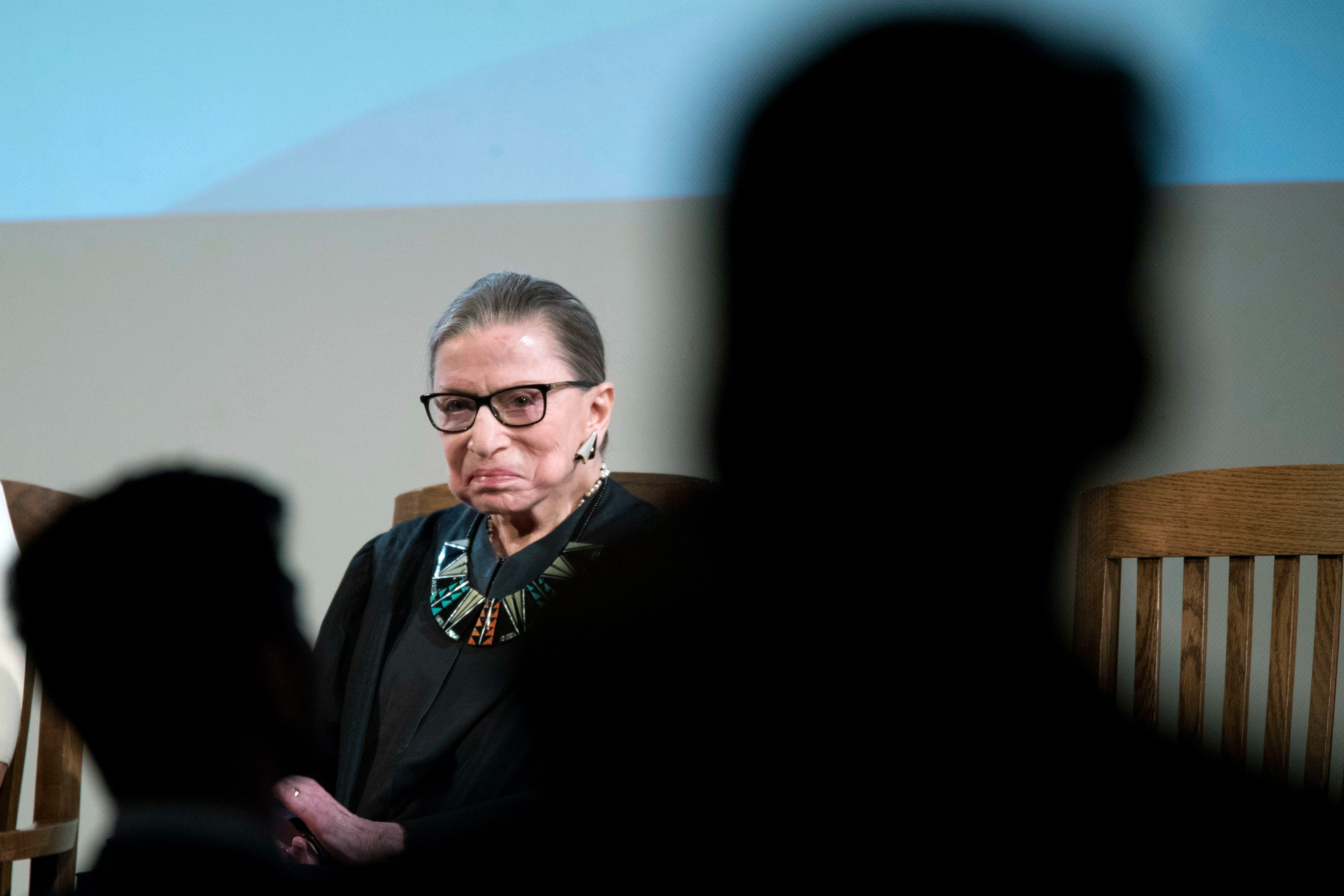 U.S. Supreme Court Justice Ruth Bader Ginsburg looks at U.S. citizenship candidates during swearing in ceremony for new American citizens, Tuesday, April 10, 2018, in New York.  Justice Ginsberg administered the Oath of Allegiance to 200 immigrants from 59 countries who became U.S. citizens.  (AP Photo/Mary Altaffer)