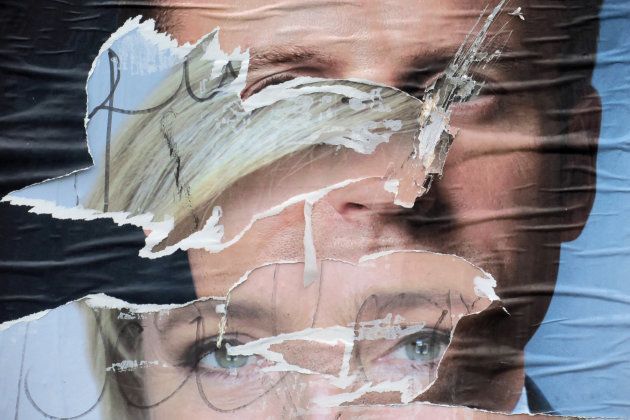 Torn and overlapping official posters of candidates for the 2017 French presidential election Marine...