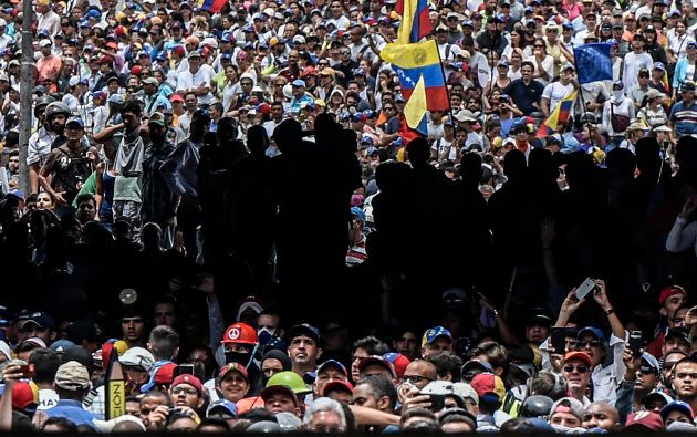 Opposition activists protest against Venezuelan President Nicolas Maduro, in Caracas on May 3, 2017.Venezuela's...