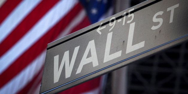 A Wall Street sign is pictured outside the New York Stock Exchange in New York, October 28, 2013.  REUTERS/Carlo Allegri/File