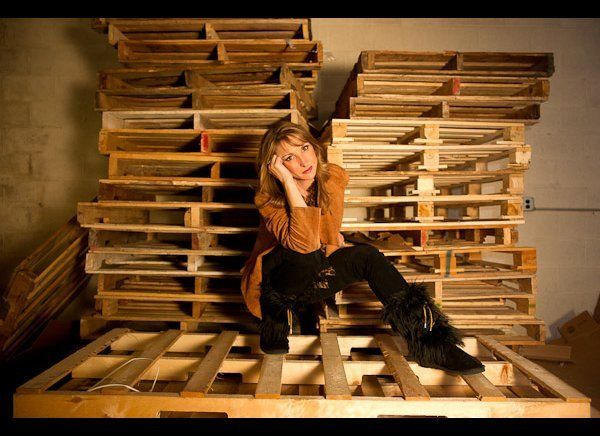 Deb Miller models her own black Sherpa Huggrz inside the company's warehouse.