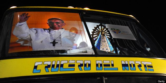 With a poster of Pope Francis and the Virgin of Lujan, the bus leading a convoy taking some 400 Argentine pilgrims to Rio de