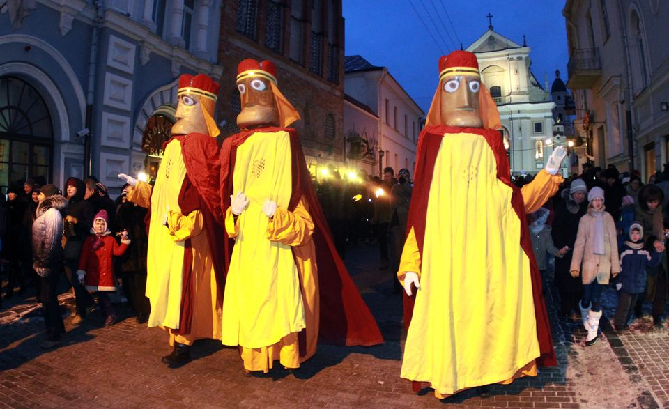 People dressed as the Three Kings walk during a traditional epiphany march in the old district of Vilnius, Lithuania, on Janu