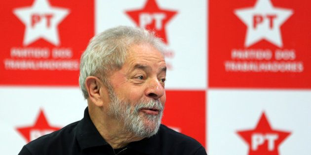 Brazil's former President Luiz Inacio Lula da Silva looks on as he attends a meeting with members of...