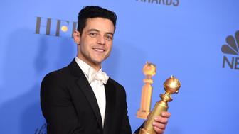 "Rami Malek poses in the press room with the award for best performance by an actor in a motion picture, drama for ""Bohemian Rhapsody"" at the 76th annual Golden Globe Awards at the Beverly Hilton Hotel on Sunday, Jan. 6, 2019, in Beverly Hills, Calif. (Photo by Jordan Strauss/Invision/AP)"
