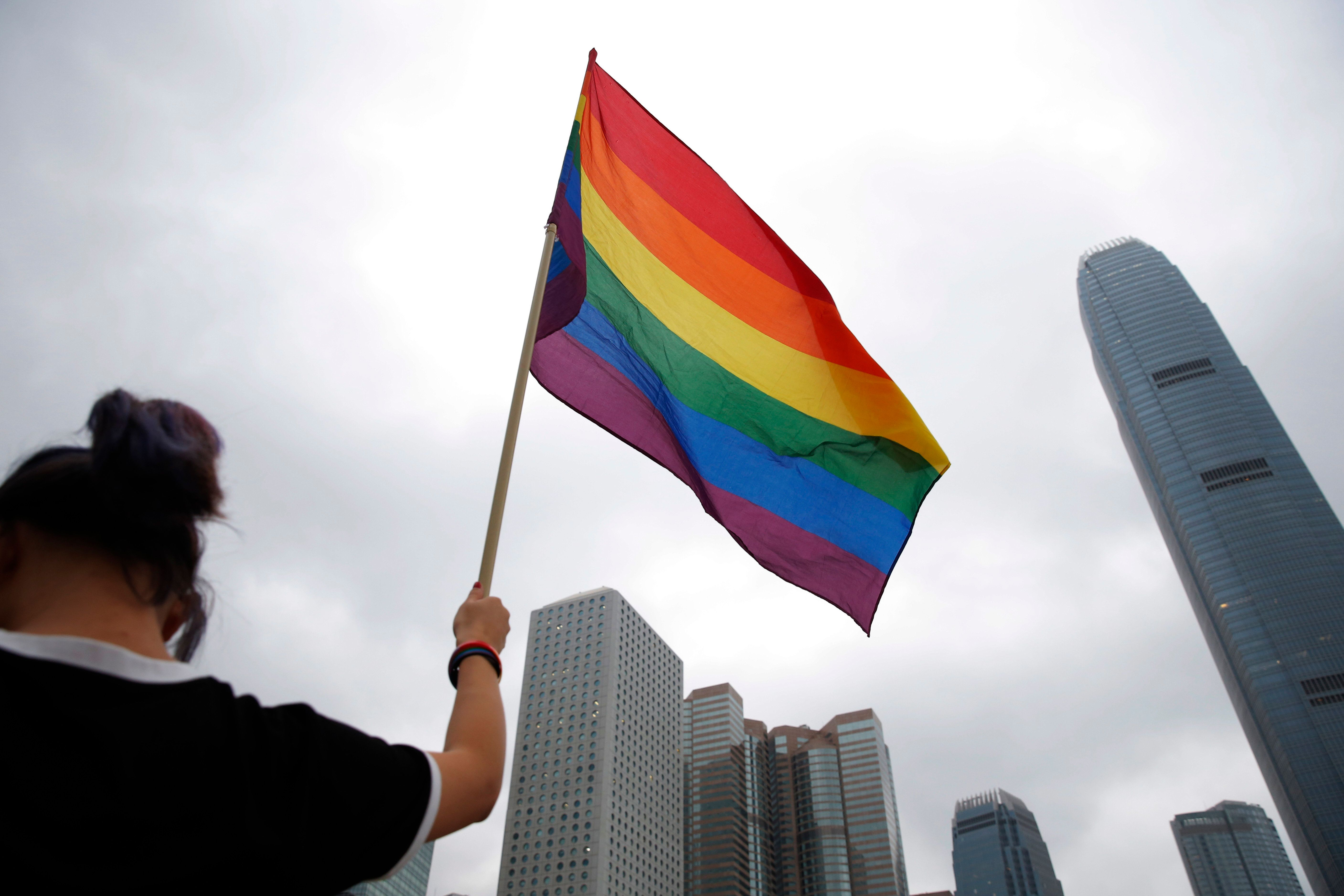 A participant holds rainbow flag at the annual Pride Parade In Hong Kong, Saturday, Nov. 17, 2018. Thousands of supporters and members of the Lesbian, Gay, Bisexual, Transgender (LGBT) community in Hong Kong gathered on Saturday to participate in the annual Pride Parade. (AP Photo/Kin Cheung)