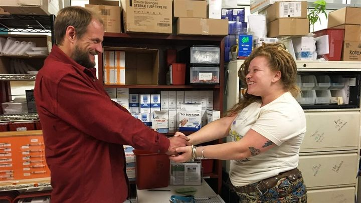 Amber Sheldon, right, greets a frequent client at the harm reduction program at Glide in San Francisco. The program offers cl