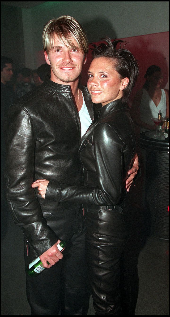 David Beckham and wife Victoria Beckham attend the Versace Store opening party on New Bond Street in 1999 in London. He