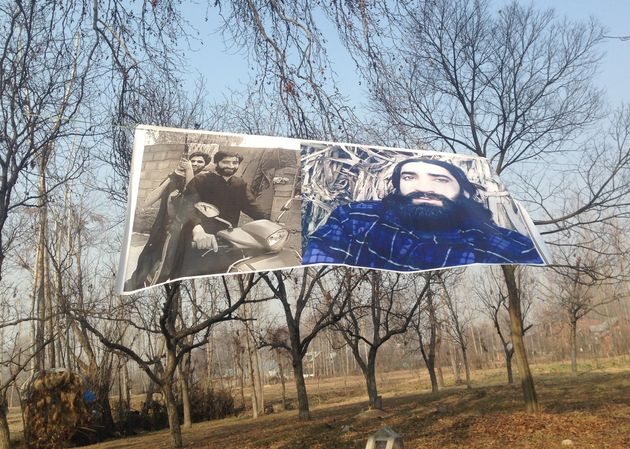 A poster of Zahoor Thokar, a slain militant, outside his village in Kashmir. Thokar, a former member...