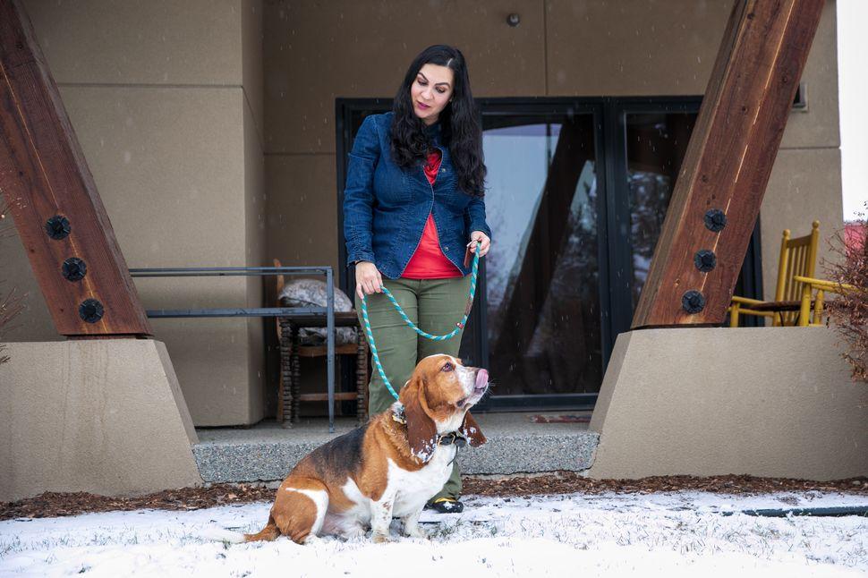 Nina Kouprianova takes her basset hound, Rody, out in Whitefish,