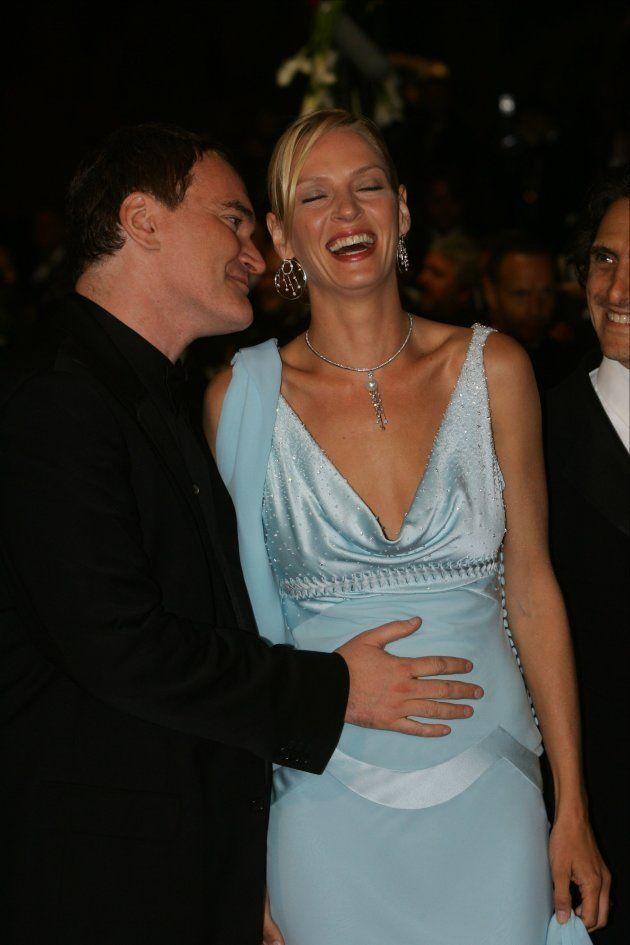Quentin Tarantino e Uma Thurman, que estava grávida, no tapete vermelho do Festival de Cannes, na França,...