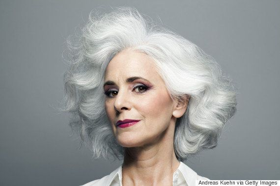 Grey haired woman with red lip stick,