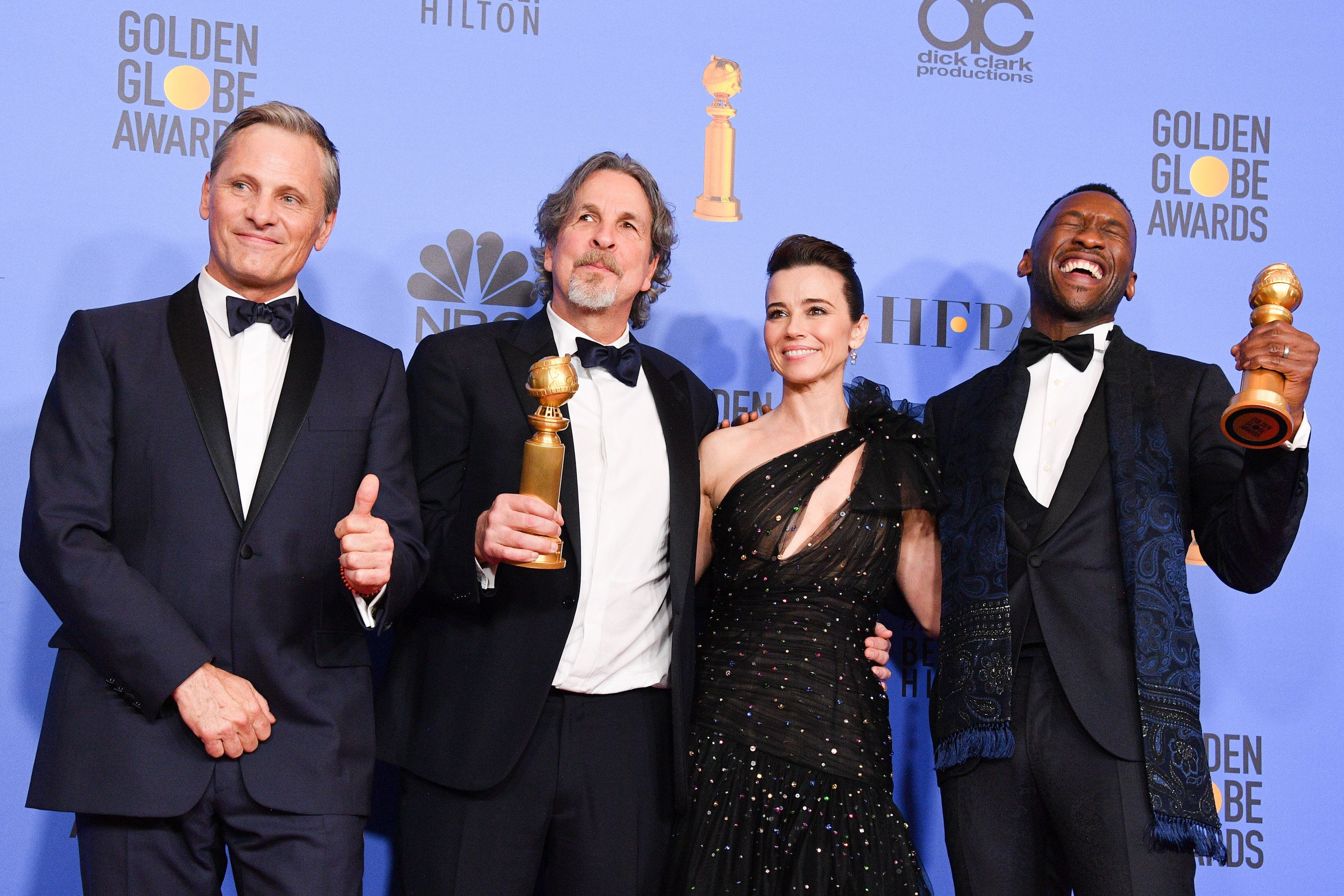 BEVERLY HILLS, CALIFORNIA - JANUARY 06: Best Motion Picture, Musical or Comedy, award for 'Green Book' winners (L-R) Viggo Mortensen, Peter Farrelly, Linda Cardellini and Mahershala Ali pose in the press room during the 75th Annual Golden Globe Awards held at The Beverly Hilton Hotel on January 06, 2019 in Beverly Hills, California. (Photo by George Pimentel/WireImage,)