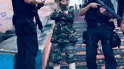 O dia em que Madonna ignorou a violência do Rio e visitou o Morro da