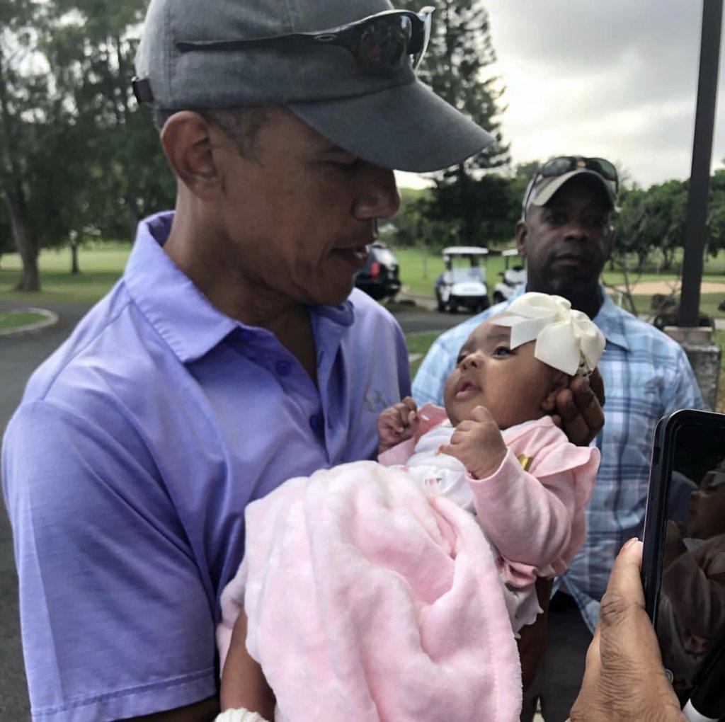 Obama holds baby