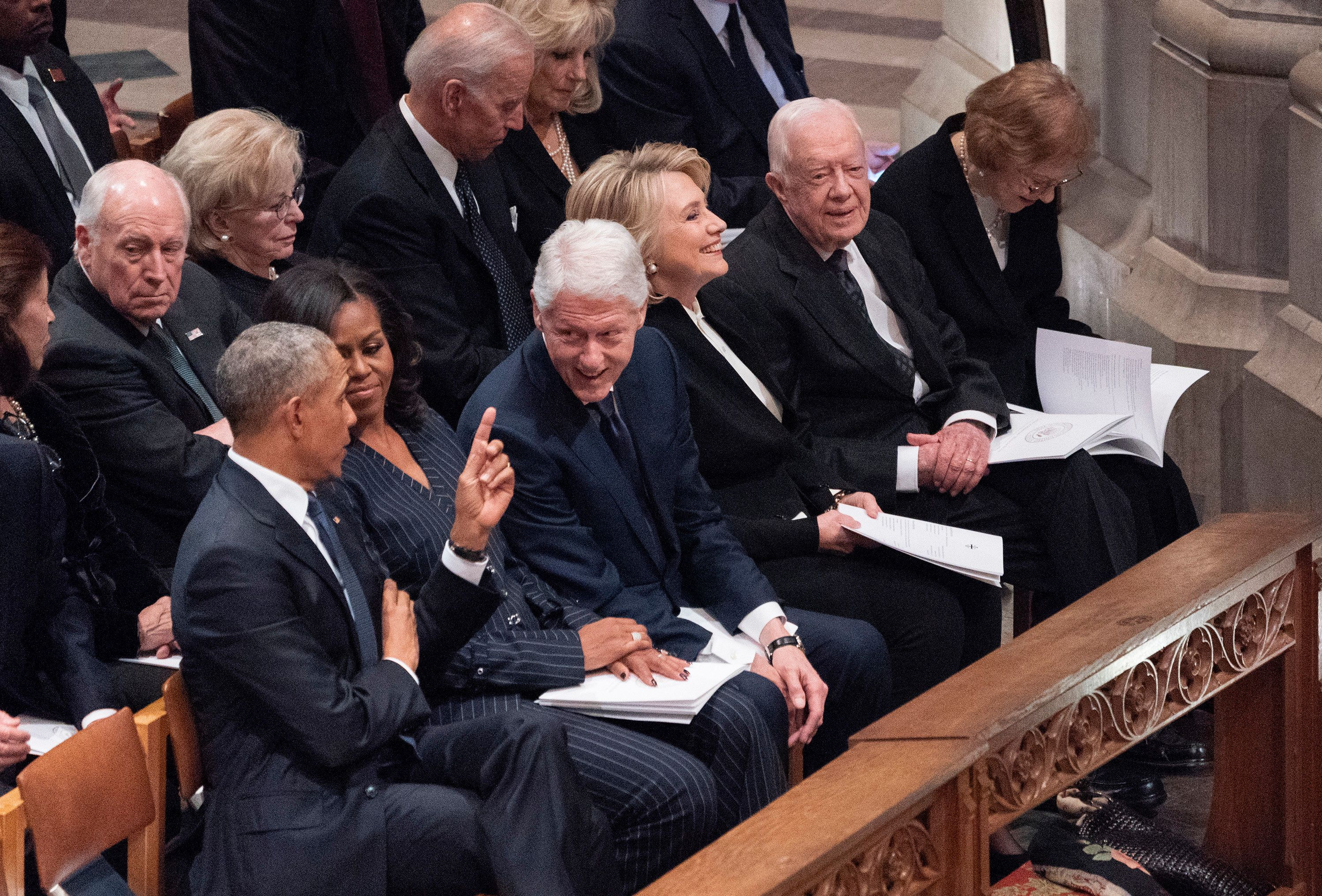 WASHINGTON, DC - DECEMBER 05: (AFP- OUT) Former President Barack Obama, Michelle Obama, Bill Clinton, Hillary Clinton, Jimmy Carter and Rosalyn Carter attend the state funeral service of former President George W. Bush at the National Cathedral, December 5, 2018 in Washington, DC. President Bush will be buried at his final resting place at the George H.W. Bush Presidential Library at Texas A&M University in College Station, Texas. A WWII combat veteran, Bush served as a member of Congress from Texas, ambassador to the United Nations, director of the CIA, vice president and 41st president of the United States. (Photo by Chris Kleponis-Pool/Getty Images)