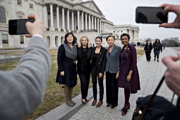 (Left to right) New York Reps. Grace Meng, Carolyn Maloney, Alexandria Ocasio-Cortez, Nydia Velazquez and Yvette Clark, all Democrats, pose for a photograph as Congress convened earlier this month. Ocasio-Cortez, the sole new lawmaker among the group, has proved a magnet for publicity.