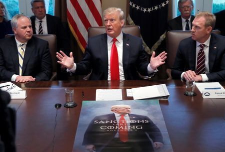 U.S. President Donald Trump (C), Acting U.S. Defense Secretary Patrick Shanahan (R) and Acting Secretary of the Interior David Bernhardt attend a Cabinet meeting on day 12 of the partial U.S. government shutdown at the White House in Washington, U.S., January 2, 2019. REUTERS/Jim Young
