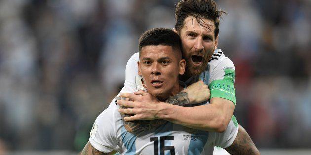 Argentina, de Rojo e Messi, sofreu, mas se garantiu nas oitavas de final da