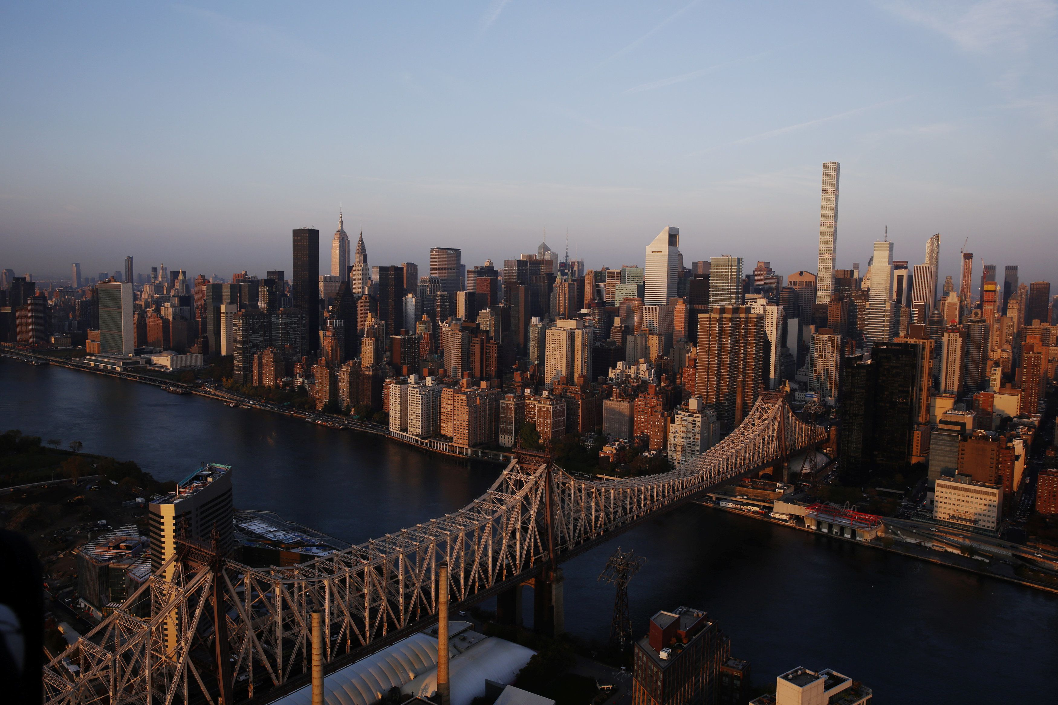 The rising sun hits the Queensboro Bridge and the Manhattan borough of New York, U.S.,November 2, 2016. REUTERS/Lucas Jackson