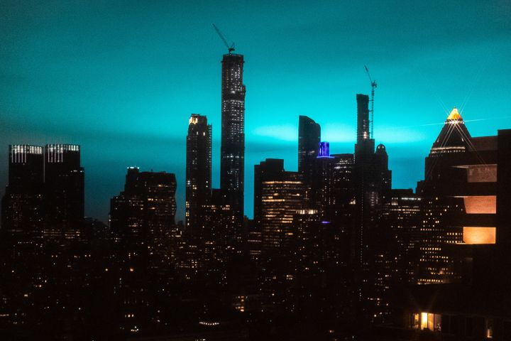 An electric arc released by an equipment malfunction at a ConEdison substation in Astoria illuminated the New York skyline la