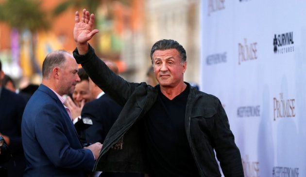 Actor Sylvester Stallone waves at the premiere of