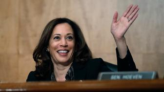 Sen. Kamala Harris, D-Calif., waves to another member of the committee during a hearing of the the Senate Committee on Homeland Security and Governmental Affairs for Steven D. Dillingham to be Director of the Census, on Capitol Hill, Wednesday, Oct. 3, 2018 in Washington. (AP Photo/Alex Brandon)