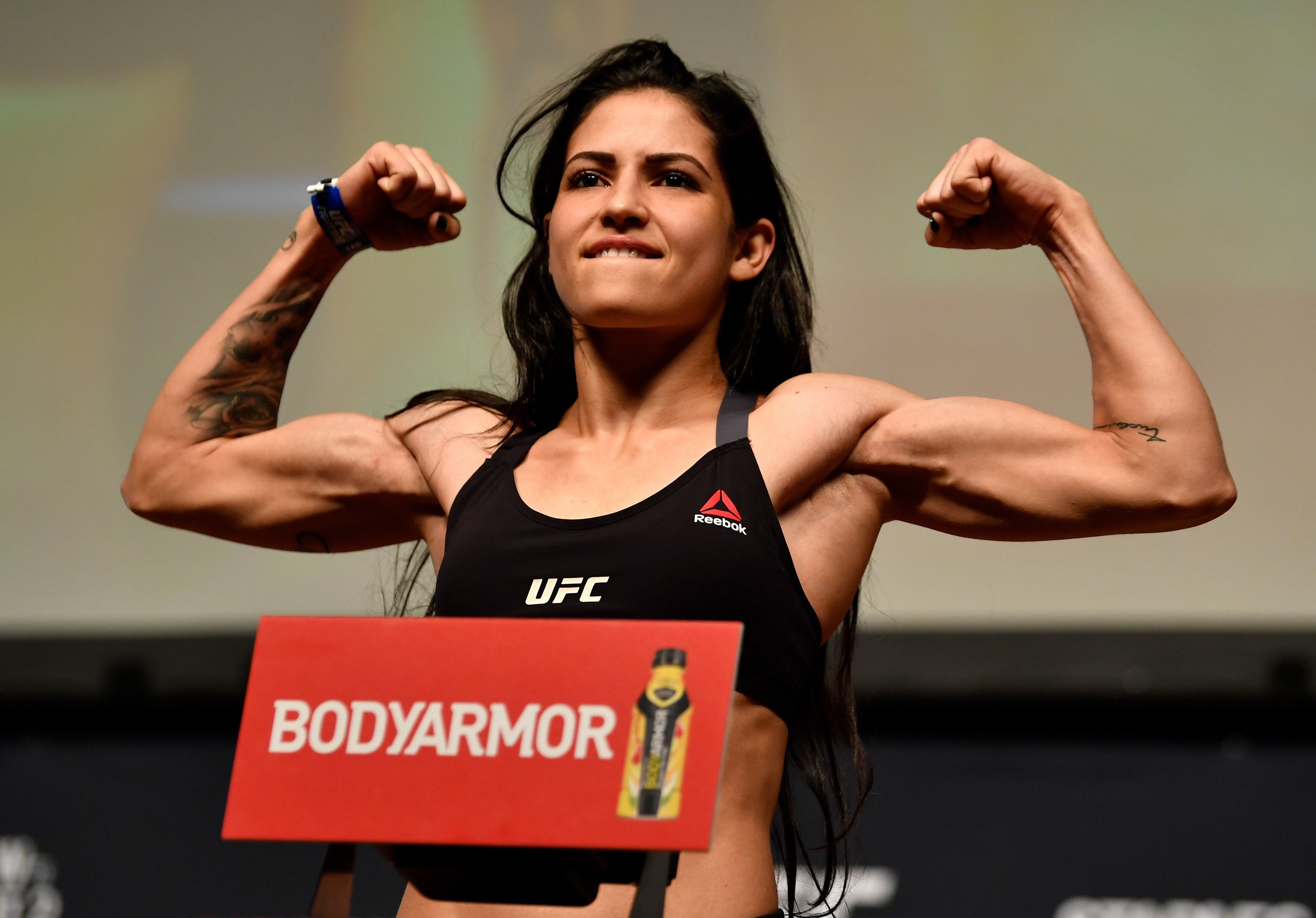 LOS ANGELES, CA - AUGUST 03:  Polyana Viana of Brazil poses on the scale during the UFC 227 weigh-in inside the Orpheum Theater on August 3, 2018 in Los Angeles, California. (Photo by Jeff Bottari/Zuffa LLC/Zuffa LLC via Getty Images)