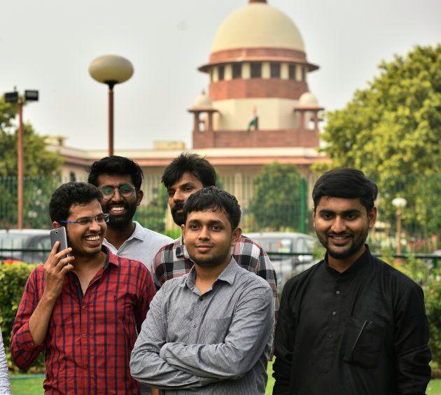 Nova Déli, Índia, 10 de julho: Krishna Reddy Medikonda (à esq.), Akhilesh Godi (atrás, à esq.), Anurag...