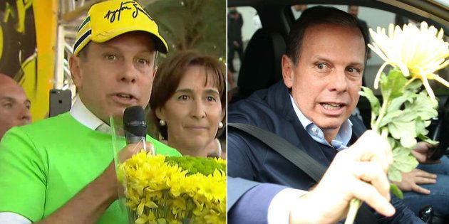 Prefeito de São Paulo, João Doria (PSDB) joga flor entregue por ciclista no