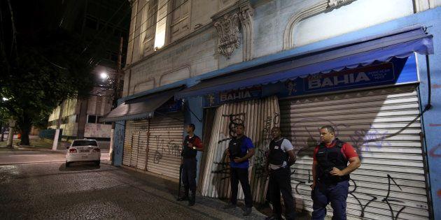 Private security guard a store in downtown Vitoria, Espirito Santo, Brazil, February 7, 2016. REUTERS/Paulo