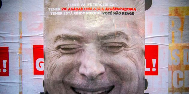 Cartaz a favor da greve geral com imagem do presidente Michel