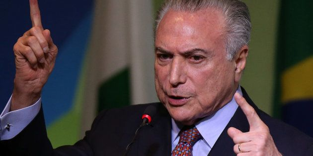 Brazilian President Michel Temer talks to the audience during the Brazilian Steel Conference in Brasilia,...