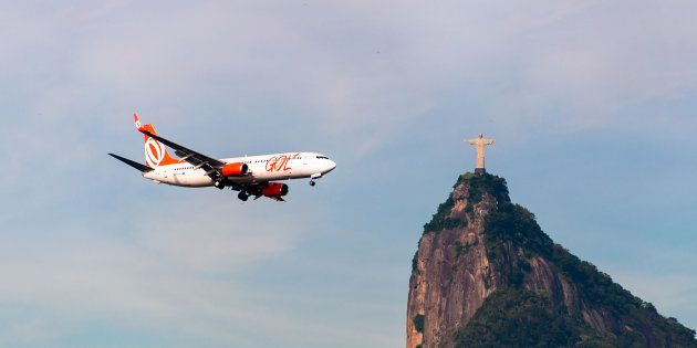 Rio de Janeiro, Brazil - February 26, 2016: Gol Airlines aircraft is flying towards the Christ the Redeemer...