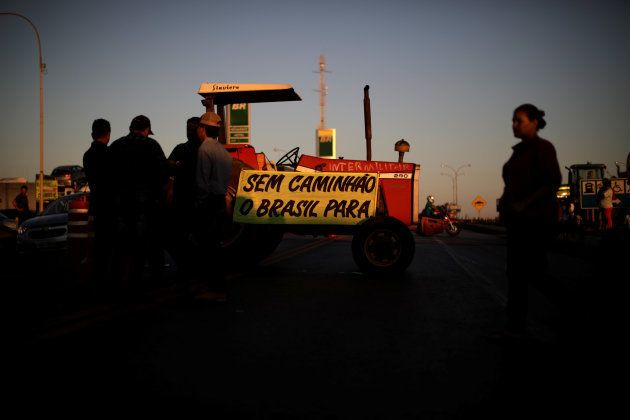 Farmers attend a protest in support of the truck drivers strike in Cristalina, Brazil May 25, 2018. Signs...
