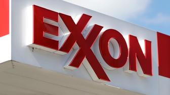 This April 25, 2017, photo, shows an Exxon service station sign in Nashville, Tenn. On Wednesday, May 31, 2017, Exxon Mobil shareholders pushed the company to share more information about whether regulations designed to reduce climate change will hurt the oil giant's business. (AP Photo/Mark Humphrey)