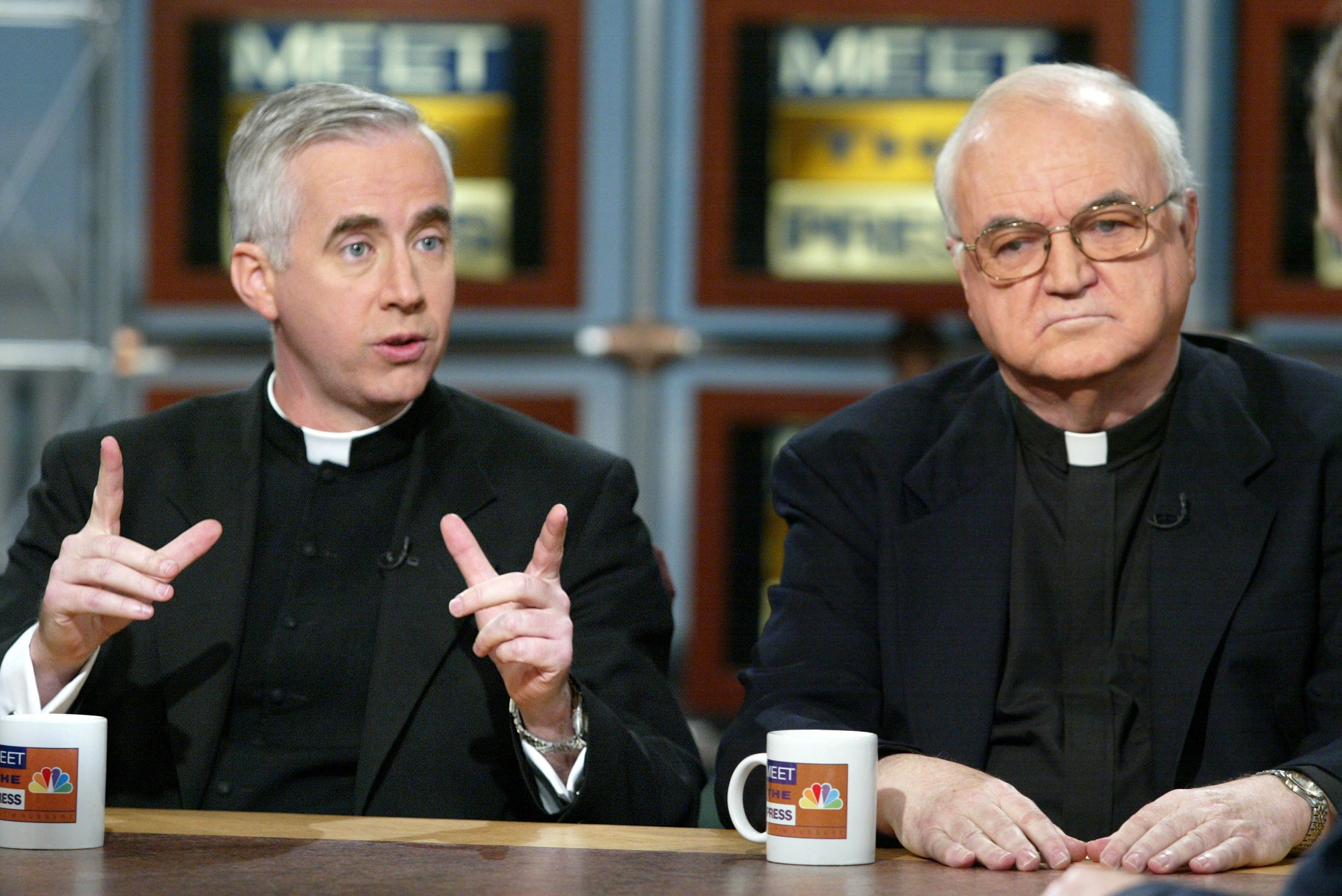 403016 02: Father John McCloskey (L) of the Catholic Information Center, and Father Richard McBrien (R) of the University of Notre Dame talk about the recent sex scandals of Catholic Church on NBC's ''Meet the Press'' March 31, 2002 in Washington, DC. The interview was taped on March 27, 2002 at the NBC studios in Washington, DC. (Photo by Alex Wong/Getty Images)