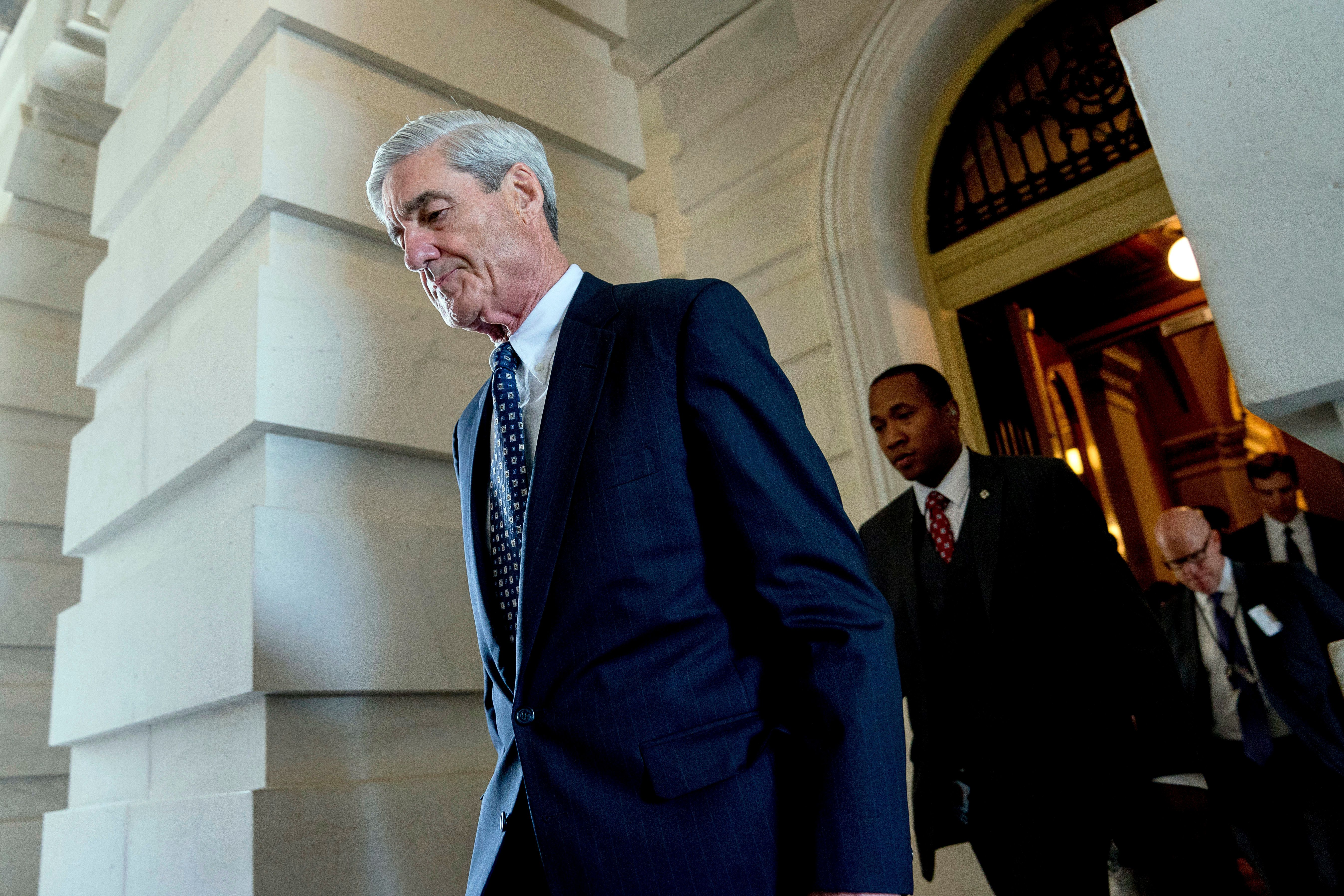 FILE - In this June 21, 2017, file photo, former FBI Director Robert Mueller, the special counsel probing Russian interference in the 2016 election, departs Capitol Hill following a closed door meeting in Washington. A 2001 Justice Department memo warned that no nation, including the United States, was immune from the threat posed by Russian organized crime. The special counsel investigation is bringing attention to Russian efforts to meddle in democratic processes, the type of intelligence gathering that in the past has relied on hired hackers. It's not clear how much the probe by Mueller will center on the criminal underbelly of Moscow, but he's already picked some lawyers with experience confronting organized crime. (AP Photo/Andrew Harnik, File)