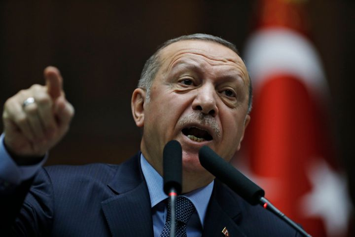 Turkey's President Recep Tayyip Erdogan gestures as he delivers a speech to MPs of his ruling Justice and Development Party (