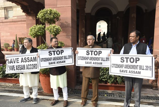 Congress MPs hold placards during a protest demanding to stop citizenship amendment bill 2016, during...