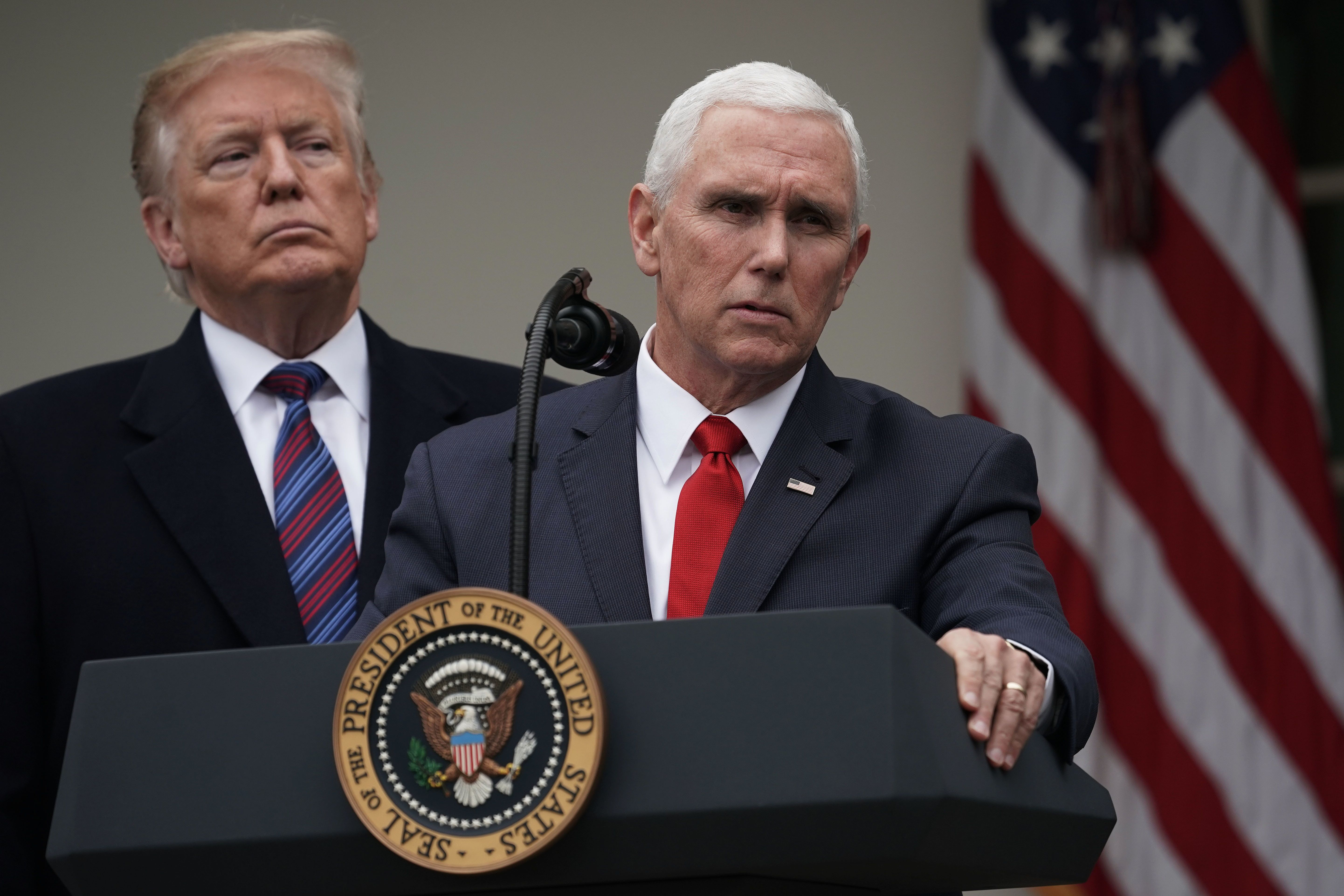 WASHINGTON, DC - JANUARY 04:  U.S. Vice President Mike Pence (R) speaks as President Donald Trump (L) listens in the Rose Garden of the White House on January 4, 2019 in Washington, DC. Trump hosted both Democratic and Republican lawmakers at the White House for the second meeting in three days as the government shutdown heads into its third week.  (Photo by Alex Wong/Getty Images)